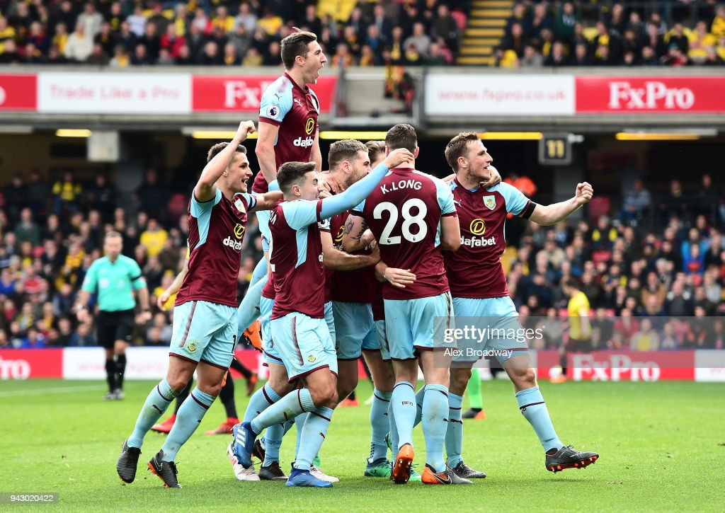 Burnley players celebrate their side's second goal during the Premier League match between Watford and Burnley at Vicarage Road on April 7, 2018 in Watford, England.