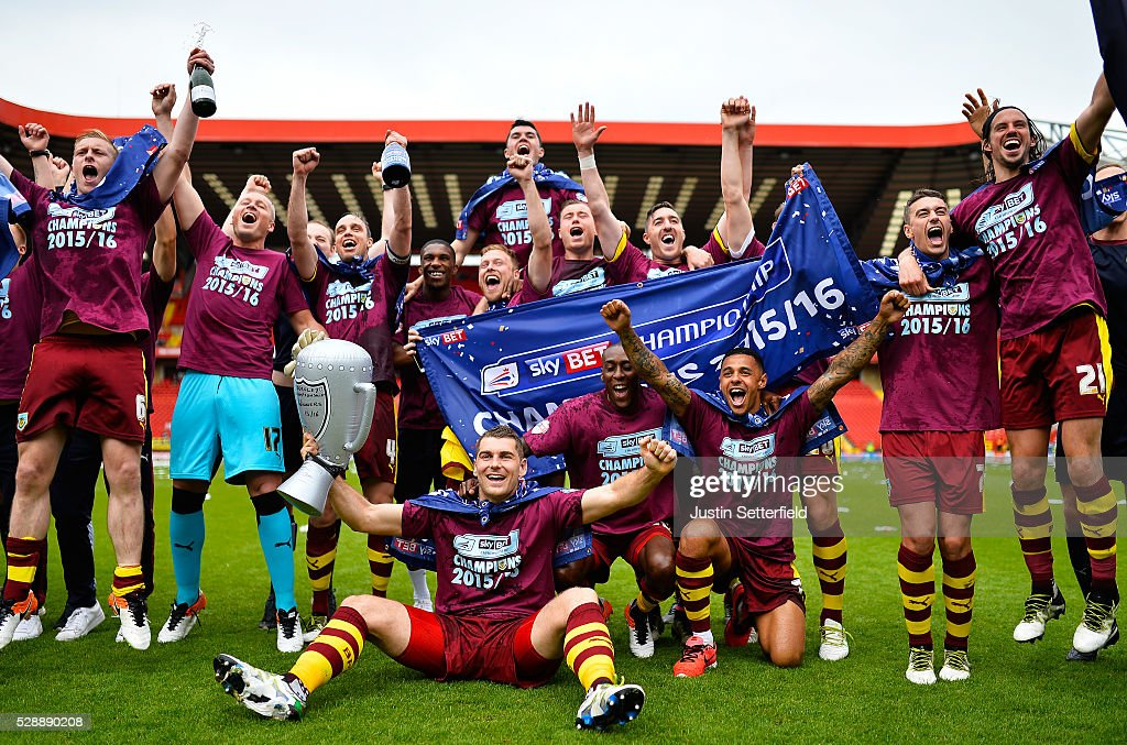 Burnley players celebrate winning the Championship after the Sky Bet Championship between Charlton Athletic and Burnley at the Valley on May 7, 2016 in London, United Kingdom.