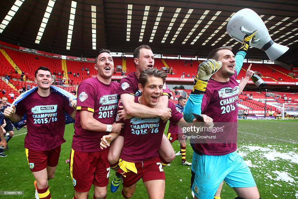 Burnley players celebrate winning the Sky Bet Championship after the Sky Bet Championship match between Charlton Athletic and Burnley on May 7, 2016 in London, United Kingdom.