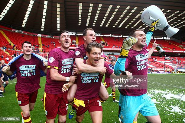 Burnley players celebrate winning the Sky Bet Championship after the Sky Bet Championship match between Charlton Athletic and Burnley on May 7, 2016...