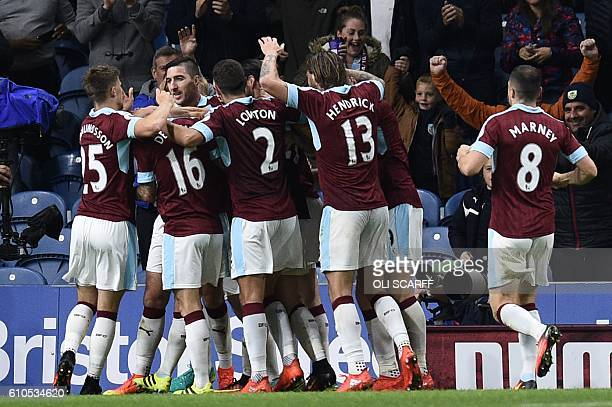 Burnley players celebrates their second goal scored by Burnley's English defender Michael Keane during the English Premier League football match...
