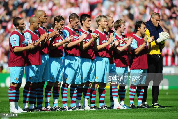 Burnley players line up in honour of Sir Bobby Moore before the Barclays Premiership match Between Stoke City and Burnley at Britannia Stadium on...