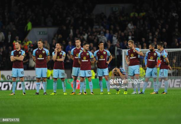 Burnley players look on after losing on penalties during the Carabao Cup Third Round match between Burnley and Leeds United at Turf Moor on September...