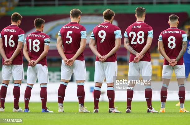 Burnley players observe a minute of silence in memory of Former England player Nobby Stiles MBE and to mark Remembrance Day prior to the Premier...