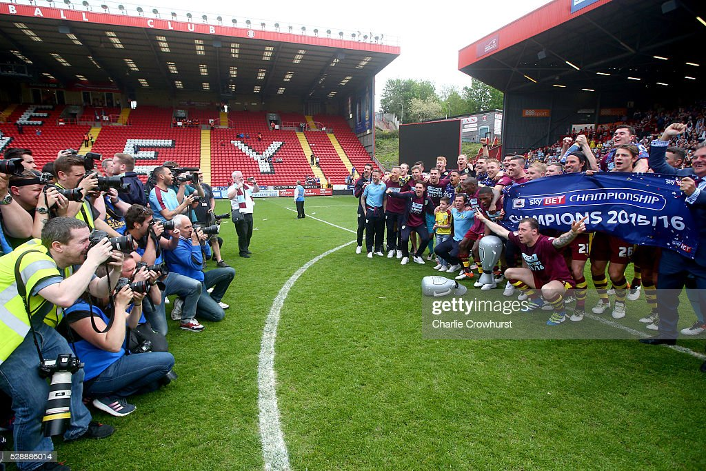 Burnley players pose for photographs while celebrating champions of the Sky Bet Championship after the Sky Bet Championship match between Charlton Athletic and Burnley on May 7, 2016 in London, United Kingdom.