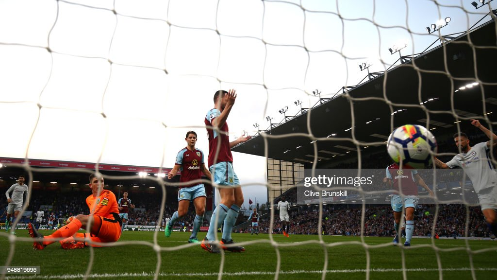 Burnley players react after Kevin Long of Burnley scores an own goal during the Premier League match between Burnley and Chelsea at Turf Moor on April 19, 2018 in Burnley, England.