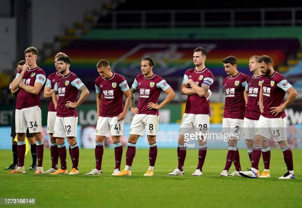 Burnley players react during the penalty shoot out during the Carabao Cup second round match between Burnley and Sheffield United at Turf Moor on...