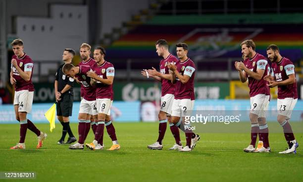 Burnley players react following the penalty shoot out during the Carabao Cup second round match between Burnley and Sheffield United at Turf Moor on...