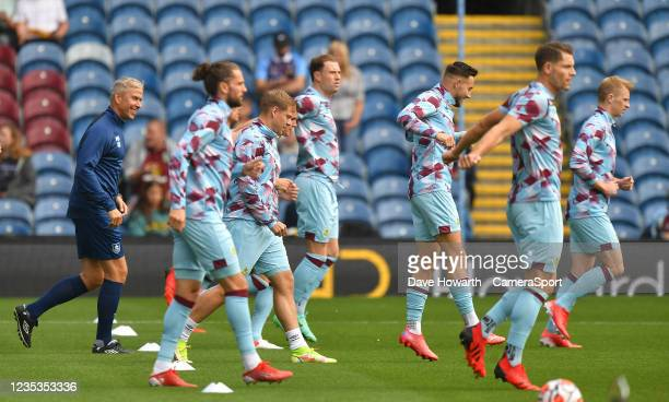 Burnley players warm up during the Premier League match between Burnley and Arsenal at Turf Moor on September 18, 2021 in Burnley, England.