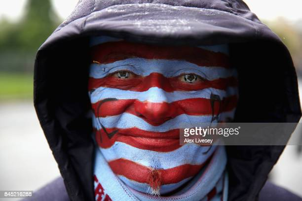 Burnley supporter poses for a portrait prior to the Premier League match between Burnley and Crystal Palace at Turf Moor on September 10 2017 in...