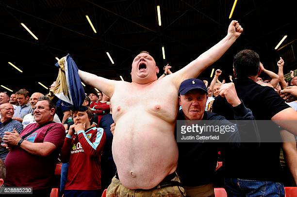 Burnley supporters celebrate their team's first goal during the Sky Bet Championship match between Charlton Athletic and Burnley on May 7 2016 in...
