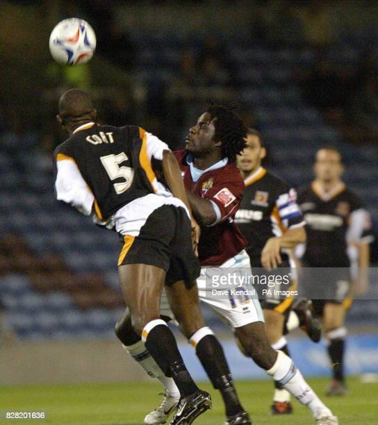 Burnley's Ade Akinbiyi challenges Hull's Leon Cort during the CocaCola Championship match at Turf Moor Burnley Friday October 28 2005 PRESS...