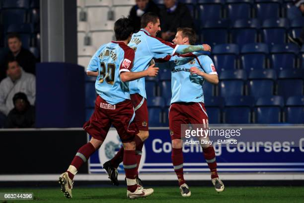 Burnley's Alan Mahon celebrates scoring his sides second goal of the game with teammates Chris McCann and Steven Thompson