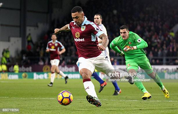 Burnley's Andre Gray scores his sides second goal during the Premier League match between Burnley and Sunderland at Turf Moor on December 31 2016 in...