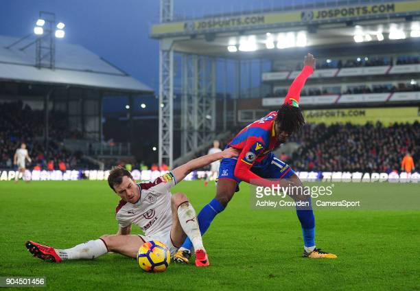 Burnley's Ashley Barnes battles with Crystal Palace's Wilfried Zaha during the Premier League match between Crystal Palace and Burnley at Selhurst...