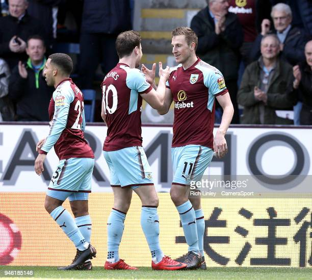 Burnley's Ashley Barnes celebrates Chris Wood's opening goal during the Premier League match between Burnley and Leicester City at Turf Moor on April...