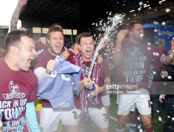 Burnley's Ashley Barnes celebrates with a bottle of champagne after his side win promotion to the Premier League during the Sky Bet Championship...