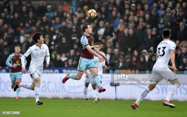 Burnley's Ashley Barnes jumps to head the ball during the Premier League match at the Liberty Stadium Swansea