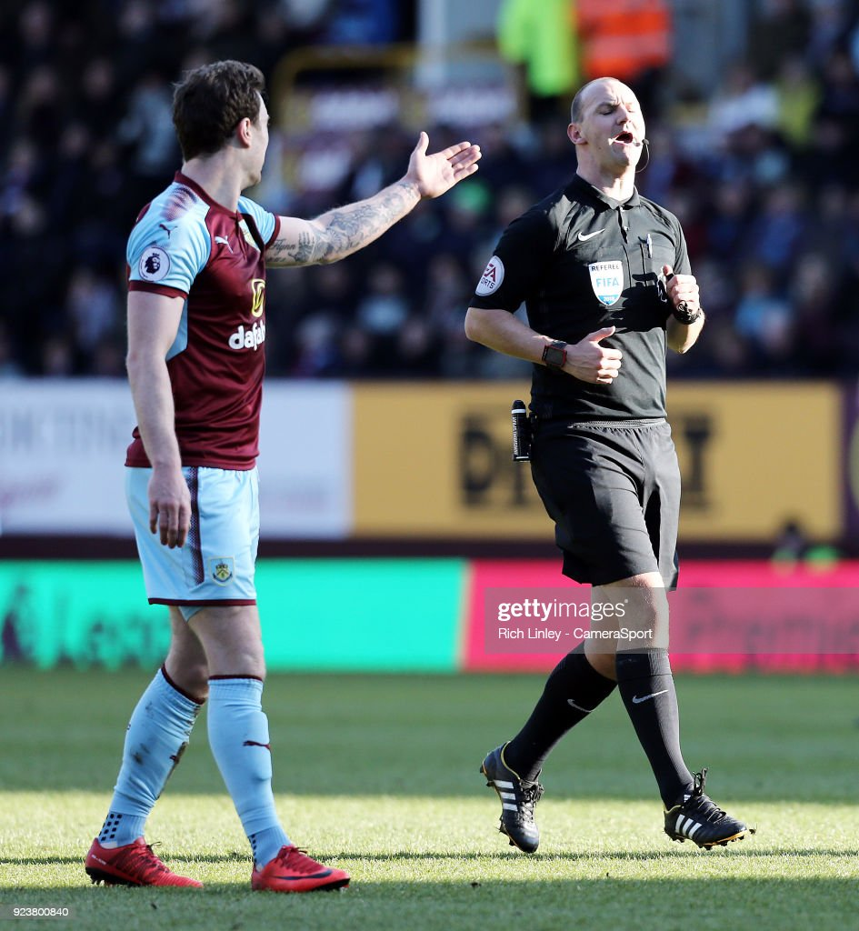 Burnley's Ashley Barnes remonstrates with referee Bobby Madley during the Premier League match between Burnley and Southampton at Turf Moor on February 24, 2018 in Burnley, England.
