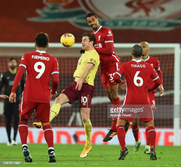 Burnley's Ashley Barnes with Joel Matip of Liverpool during the Premier League match between Liverpool and Burnley at Anfield on January 21, 2021 in...