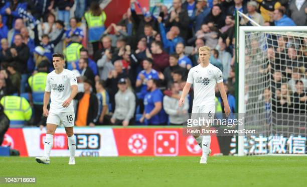 Burnley's Ashley Westwood and Ben Mee look dejected after Cardiff City's first goal scored by Josh Murphy during the Premier League match between...