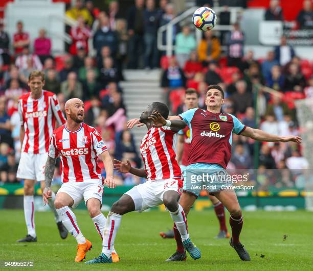 Burnley's Ashley Westwood battles with Stoke City's Papa Alioune Ndiaye during the Premier League match between Stoke City and Burnley at Bet365...
