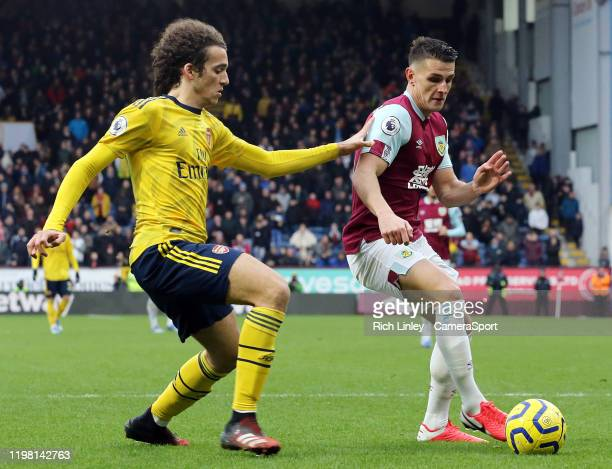 Burnley's Ashley Westwood shields the ball from Arsenal's Matteo Guendouzi during the Premier League match between Burnley FC and Arsenal FC at Turf...