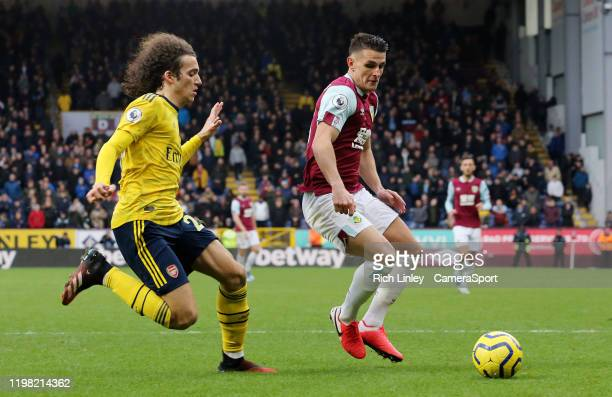 Burnley's Ashley Westwood vies for possession with Arsenal's Matteo Guendouzi during the Premier League match between Burnley FC and Arsenal FC at...