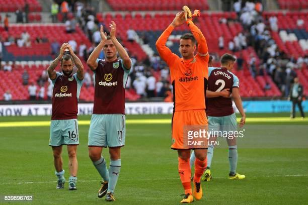 Burnley's Belgian midfielder Steven Defour Burnley's New Zealand Striker Chris Wood and Burnley's English goalkeeper Tom Heaton applaud the...