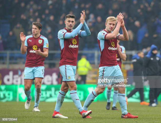 Burnley's Ben Mee Matthew Lowton and James Tarkowski applaud the fans after the match during the Premier League match between Burnley and Everton at...