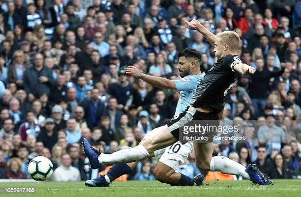 Burnley's Ben Mee tackles Manchester City's Sergio Aguero during the Premier League match between Manchester City and Burnley FC at Etihad Stadium on...