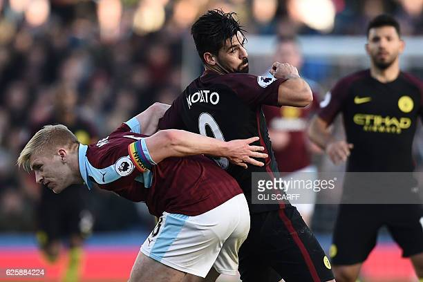 Burnley's captain Ben Mee wearing a rainbow armband vies with Manchester City's Spanish midfielder Nolito during the English Premier League football...