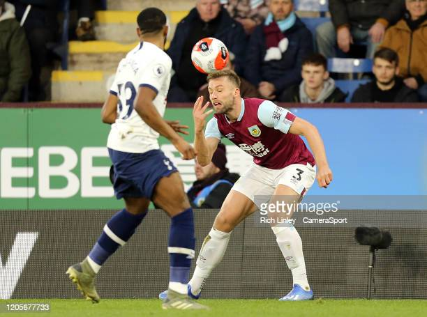 Burnley's Charlie Taylor heads under pressure from Tottenham Hotspur's Japhet Tanganga during the Premier League match between Burnley FC and...