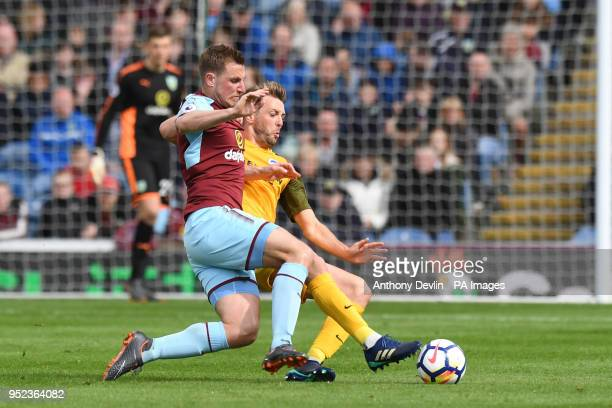 Burnley's Chris Wood and Brighton and Hove Albion's Dale Stephens battle for the ball during the Premier League match at Turf Moor Burnley