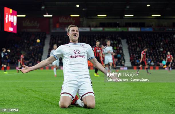 Burnley's Chris Wood celebrates scoring the opening goal during the Premier League match between AFC Bournemouth and Burnley at Vitality Stadium on...