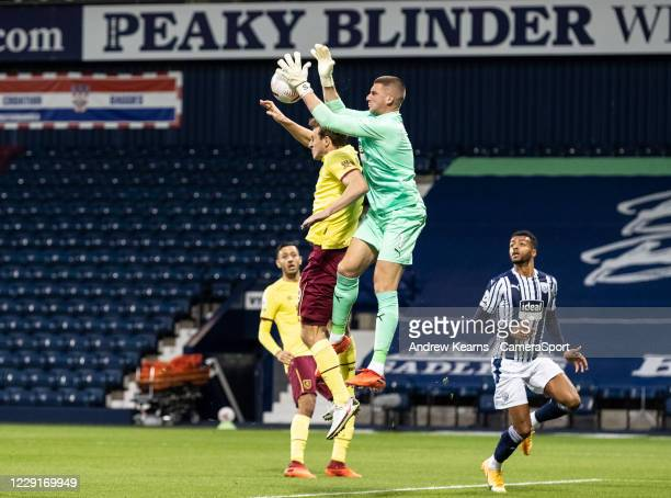 Burnley's Chris Wood competing with West Bromwich Albion's goalkeeper Sam Johnstone during the Premier League match between West Bromwich Albion and...