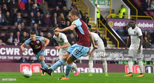 Burnley's Chris Wood scores his team's equalising goal during the Carabao Cup Third Round match between Burnley and Leeds United at Turf Moor on...