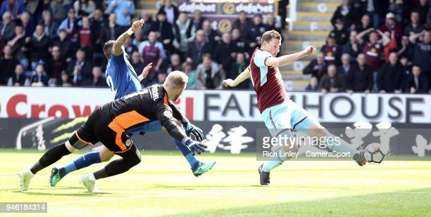 Burnley's Chris Wood scores the opening goal past Leicester City's Kasper Schmeichel during the Premier League match between Burnley and Leicester...