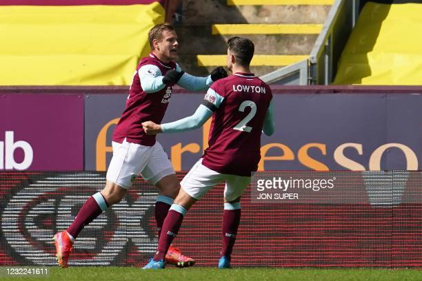 Burnley's Czech striker Matej Vydra celebrates with Burnley's English defender Matthew Lowton after scoring the first goal during the English Premier...