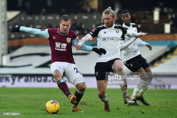 Burnley's Czech striker Matej Vydra Fulham's US defender Tim Ream during the English FA Cup fourth round football match between Fulham and Burnley at...
