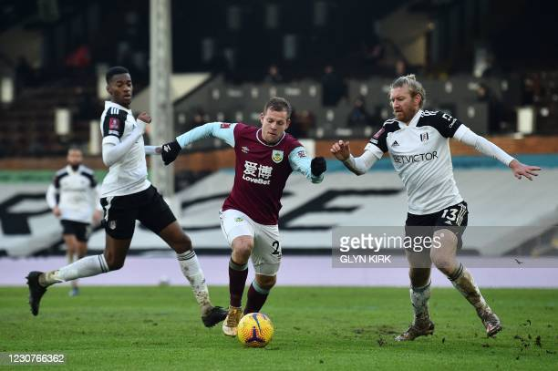 Burnley's Czech striker Matej Vydra runs with the ball as Fulham's US defender Tim Ream closes in during the English FA Cup fourth round football...