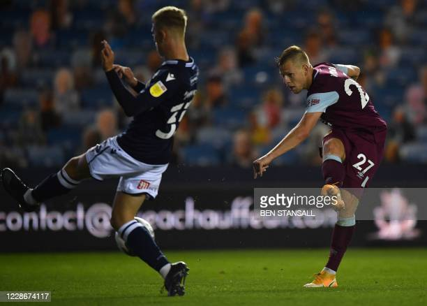 Burnley's Czech striker Matej Vydra shoots but fails to score during the English League Cup third round football match between Millwall and Burnley...