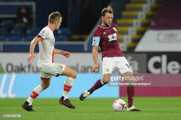 Burnley's Dale Stephens under pressure from Southampton's James WardProwse during the Premier League match between Burnley and Southampton at Turf...