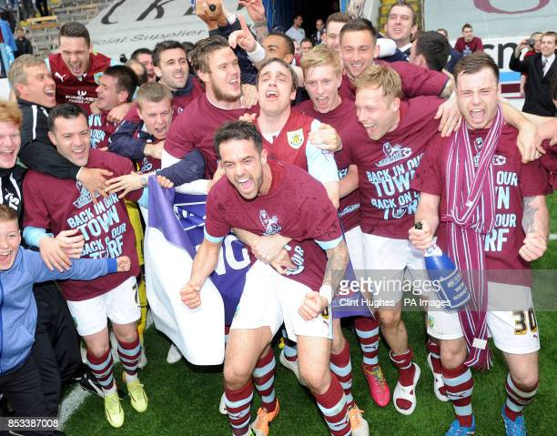 Burnley's Danny Ings leads the celebrations after his side win promotion to the Premier League during the Sky Bet Championship match at Turf Moor...