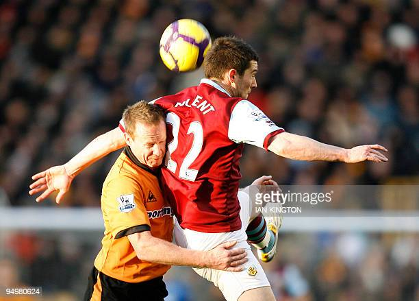 Burnley's David Nugent vies with Wolverhampton Wanderers Steven Caldwell during a Premier League match at Molineux Stadium in Wolverhampton West...