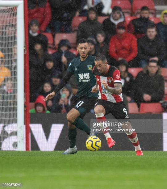 Burnley's Dwight McNeil battles for possession with Southampton's Danny Ings during the Premier League match between Southampton FC and Burnley FC at...