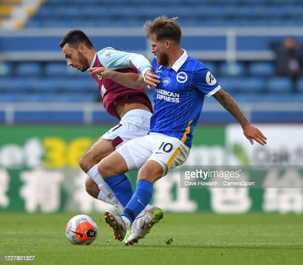 Burnley's Dwight McNeil battles with Brighton Hove Albion's Alexis Mac Allister during the Premier League match between Burnley FC and Brighton Hove...