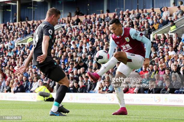 Burnley's Dwight McNeil controls under pressure from Liverpool's Jordan Henderson during the Premier League match between Burnley FC and Liverpool FC...