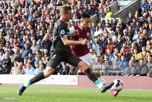 Burnley's Dwight McNeil under pressure from Liverpool's Jordan Henderson during the Premier League match between Burnley FC and Liverpool FC at Turf...