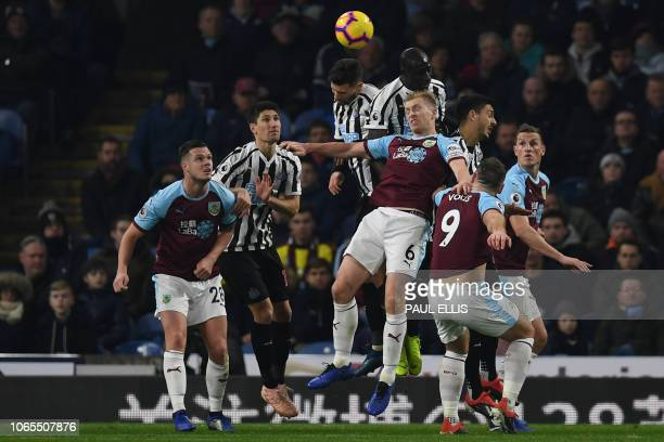 Burnley's English defender Ben Mee jumps to head the ball during the English Premier League football match between Burnley and Newcastle United at...